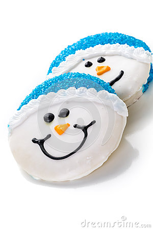 frosted white sugar cookies in shape of snowman