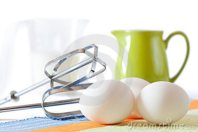 Cookies making: eggs, jug, spoons, form