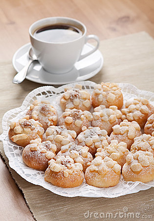 Cookies sprinkled with sugar a cup of coffee