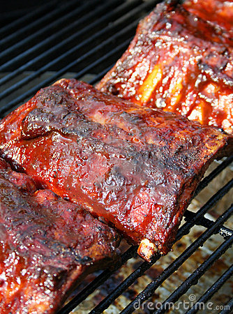 Cooking barbecue pork ribs on a grill
