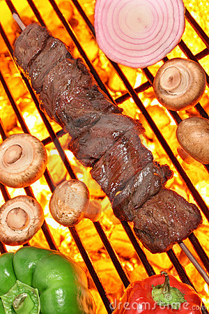 Cooking beef kebab on barbecue grill