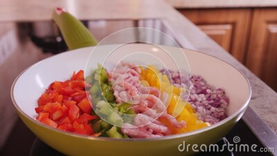 Cooking delicious food - ingredients placed in strips inside a pan stock footage