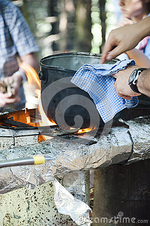 Cooking dinner on campfire
