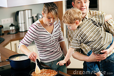 Cooking in family - stirring the sauce
