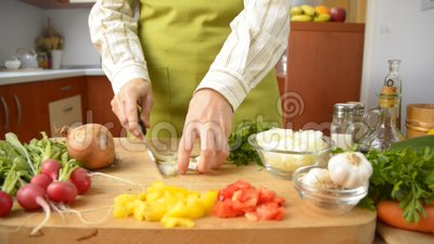 Cooking. Female hands slicing onion and parsley, dolly shot
