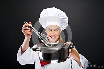 Cooking and food concept - smiling female chef
