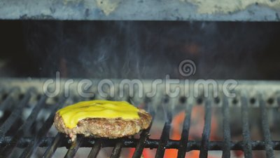 Cooking fresh juicy cheeseburger cheesecakes for street food.  stock footage