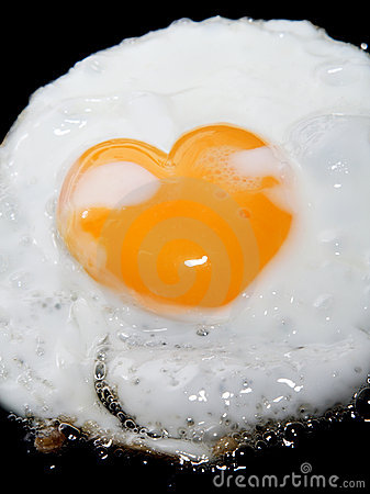 Free Cooking Frying Egg With Heart Shape Yolk On Black Royalty Free Stock Photo - 6725755