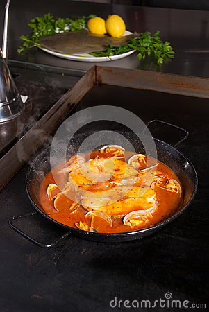 Cooking hake in cider sauce