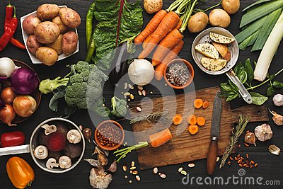 Sliced carrots with knife on wooden cutting board, background Stock Photo