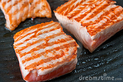 Cooking salmon steak on the grill