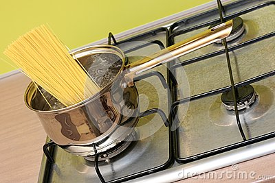 Cooking spaghetti pasta in a pot