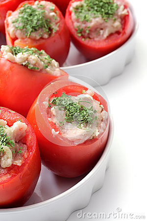 Cooking tomatoes stuffed with chicken meat