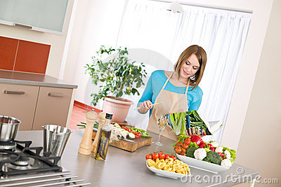 Cooking - Woman reading cookbook in kitchen