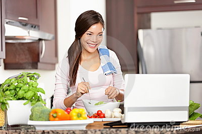 Cooking woman using computer