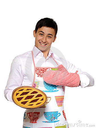 Cooking. Young man in apron baked tasty pie