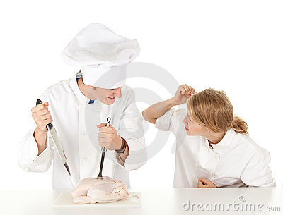 Cooks team preparing raw chicken