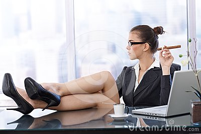 Cool businesswoman with feet up