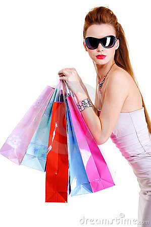 Cool female with shopping bags after shoppings
