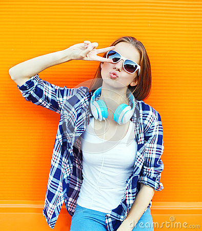 Free Cool Girl Having Fun Listens Music In Headphones Over Colorful Stock Photography - 70333752