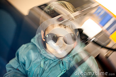 Cool kid traveling by car
