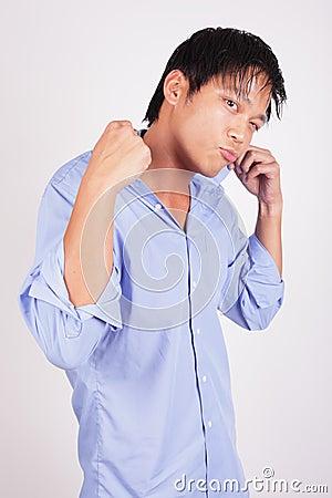 Cool man adjusting his collar