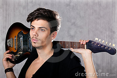 Cool man with electric guitar