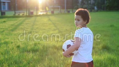 Video portrait of football player boy with the ball in the park stock video footage