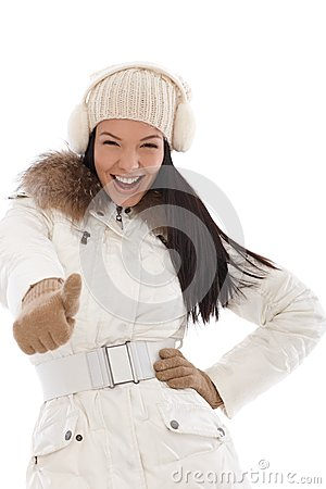 Cool woman with thumb up at wintertime