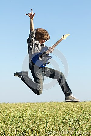 Cool young guitarist jumping