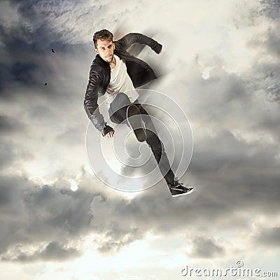 Cool young man jumping and kicking