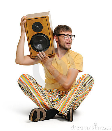 Cool young man with wood speaker