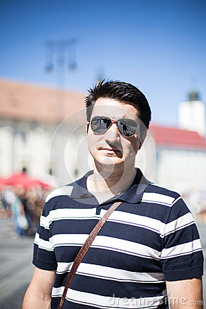 Cool young traveller with sunglasses