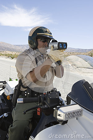Cop Monitoring Speed Though Radar Gun