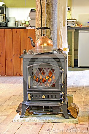 Copper kettle and fireplace