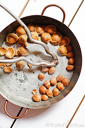 Copper pot with apricot seeds