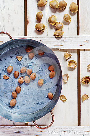 Free Copper Pot With Apricot Pits Royalty Free Stock Image - 26567416