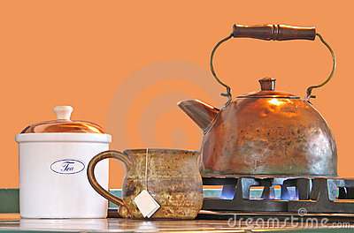 Copper tea kettle with mug and canister