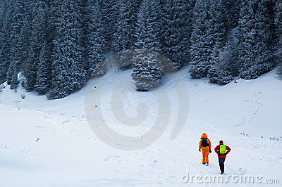 Copule  backpackers in winter forest
