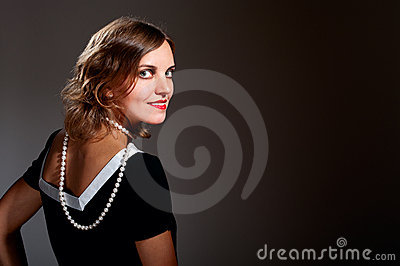 Coquette retro woman in pearls