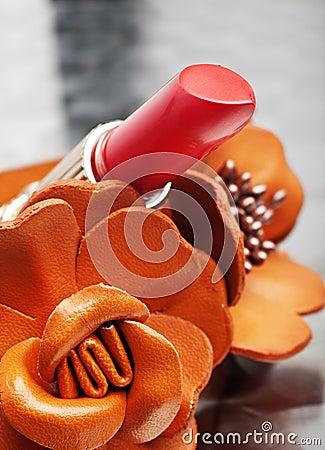Coral pink lipstick close-up
