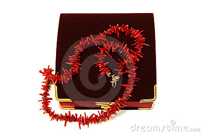 Coral red beads (necklace) and crimson velvet box.