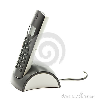 Cordless phone in cradle on white background.