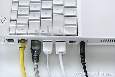 Cords Plugged Into Laptop Computer