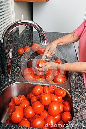 Coring tomatoes.