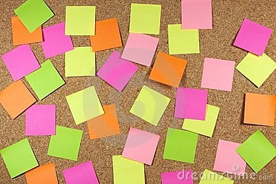 Cork board with sticky note