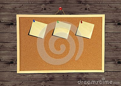 Cork bulletin board on wood wall