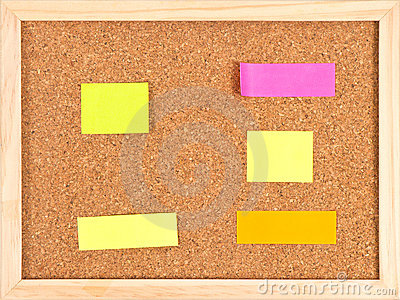Cork notice board with colorful stickeres