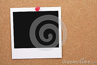 Corkboard and blank photo