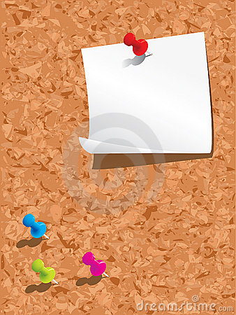 Corkboard with paper and pins
